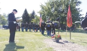 The Sons of Union Veterans of the Civil War gathered at Crestwood Cemetery on Sunday to honor their fallen brother one more time. Photo by Lania Rocha