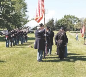 """The service included a rifle salute, prayers and """"Taps."""" Photo by Lania Rocha"""