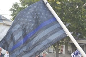 """An example of a Thin Blue Line flag, as flown in a 2020 """"We Back the Badge"""" parade in Flushing. File photo"""