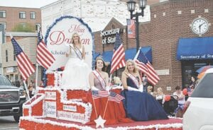 Miss Davison and her court ride in the Festival of Flags Parade in 2019. File photo