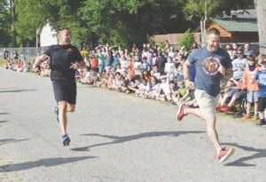 Principal Rob Steinhaus (right) edged out Sheriff Chris Swanson for the win. Photos by Ben Gagnon