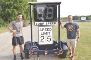 Colin Coulter (left) and Rob Steinhaus (right) with the radar speed trailer.