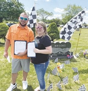 Kyle and Kelsey Brooks receive tribute letters in honor of their father. Photos provided