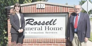 Lindsay Caterer (left) purchased Rossell Funeral Home from Ralph Rossell (right) on June 4. Photo provided