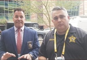 Genesee County Sheriff Chris Swanson and Hennepin County Sheriff David Hutchinson in Phoenix, AZ last week, announcing that IGNITE will be coming to Hutchinson's Minnesota jail. Photo/Screen capture from Facebook