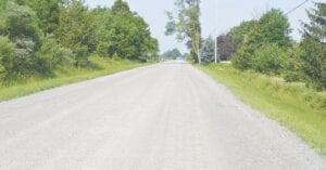 Carpenter Road between Duffield Road and M-13 (Sheridan Road) received a Perma- Zyme treatment earlier this summer. Photo by Ben Gagnon