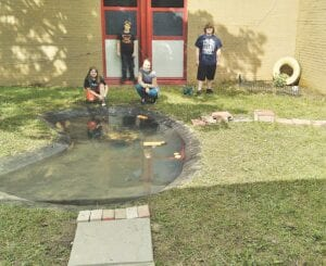 Students with the finished courtyard.