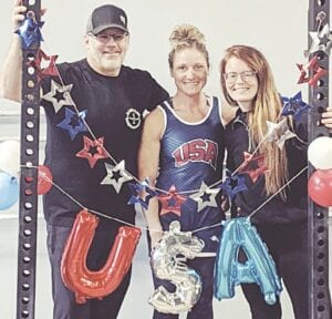 Traci Beaune (center) won a 2021 World Masters Weightlifting Championship this spring. Photo provided