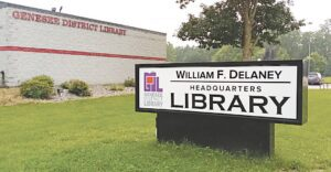 The sign outside the Genesee District Library headquarters in Flint is a reminder of former Grand Blanc Township Supervisor William F. Delaney's contributions to the county library system. Photos by Lania Rocha