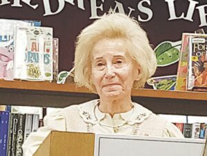 Mary Delaney thanks the Genesee District Library board for honoring her late husband, former Grand Blanc Township Supervisor William F. Delaney, by naming the library headquarters after him.