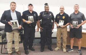 Four Clayton Township Police officers who received recognition for exemplary work are pictured here with police Chief Charlotte Brown. They are, from left, Rod Wurtz, Officer Richard Lee, Detective Sgt. Troy Belanger and Detective Ken Engel. Photo by Lania Rocha