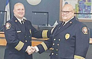 Burton Fire Chief Kirk Wilkinson, left, congratulates Battalion Chief James Lincoln on his promotion. Photos courtesy of the Burton Fire Department/Facebook