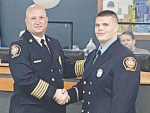 Wilkinson congratulates Lt. Joshua Mather, right, on his promotion.