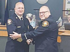 Wilkinson congratulates Lt. Greg Pray, right, on his promotion.