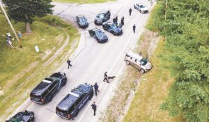 An aerial view from a drone above Sunday's crash scene on Gale Road at E. Court Street shows the suspect's vehicle in the ditch, surrounded by police officers and at least one K-9 unit. Photo courtesy of Richi K. Pedersen