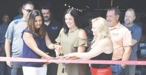 New owners cutting the ribbon on Jack's Place. Photos by Ben Gagnon