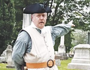 Aaron Wiles, in character as Revolutionary War soldier Nathan Burpee, talks about the founding of Grand Blanc during the Historic District Commission's first-ever Ghost Walk. Photo by Lania Rocha