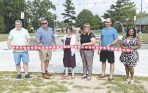 Grand Blanc dignitaries gather at Physicians Park for the official grand opening of the new splash pad. Courtesy photo