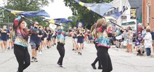 Festival-goers lined the village byways Saturday morning for the traditional Good Times in Goodrich parade. The crowd then made it's way to Goodrich Commons for more family fun. Photo by Lania Rocha