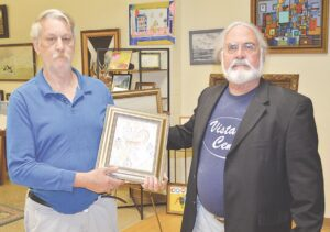 Jerry Galvas (left) displays his framed drawing alongside Vista Center Director Patrick Beal (right). Photo by Ben Gagnon