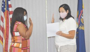 La Cracha Handy (left) received the oath of office at a special meeting held on Tuesday. Photo by Ben Gagnon