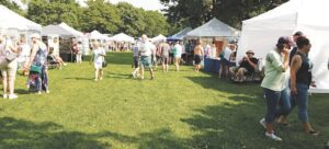 More than 1,500 people attended the 12th annual Art in the Park art fair Saturday at Elms Park. Photo by Lania Rocha