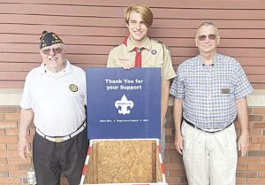 Ethan Rice presenting his Eagle Scout project with John Howe, Commander of American Legion Post #283 (left) and Dan Anderson, President of the Flushing Area Historical Society (right). Rice, 17, was also a flag bearer for the American Legion during the 2021 Flushing Summer Festival. Photo provided