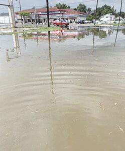 What the intersection of Saginaw Street and Schumacher Street looked like following one of the recent floods at Nicole Porcaro's house. Photo provided