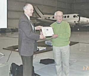 Fred McClellan (right) received a 50-year award for his service to Flint Bishop Airport in 2006. Photo provided