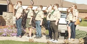 Boy Scout Troop 122 salutes the flag during the National Anthem. Photo by Lania Rocha