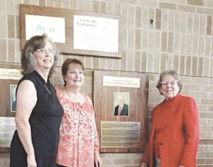 Former Swartz Creek Mayor Richard B. Abrams was one of two men posthumously honored with the renaming of the MTA Transit Center in downtown Flint. Abrams' daughters, Penny Messer and Sandi Brill, and wife, Boots Abrams, say he would have been humbled by the recognition. Photo by Lania Rocha