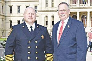 Davison-Richfield Area Fire Chief Brian Flewellling, left, with State Rep. David Martin (R-Davison) in front of the Capitol in Lansing. Photo provided