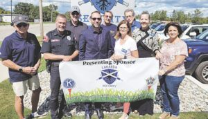 From left: Ron Rutherford-FOP, Chip Atkinson-Lagarda, Herm Clark-FOP, Chris Brown-Lagarda, and representing Kiwanis Steve Welch, Debbie Newton, Kevin Burge, Kristy Spann, and Amy Pierson.