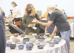 Attendees were able to select from many hand-crafted bowls to find the one they wanted to take home with them following the event. Photos by Gary Gould