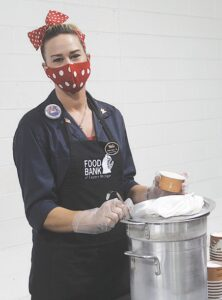 Amber Taylor, executive director of Back to the Bricks, volunteered to serve up soup to the attendees of the Empty Bowls event.